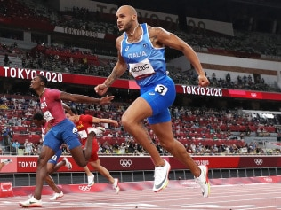 TOKYO, JAPAN - AUGUST 01: Lamont Marcell Jacobs of Team Italy wins the Men's 100m Final on day nine of the Tokyo 2020 Olympic Games at Olympic Stadium on August 01, 2021 in Tokyo, Japan. (Photo by Cameron Spencer/Getty Images)