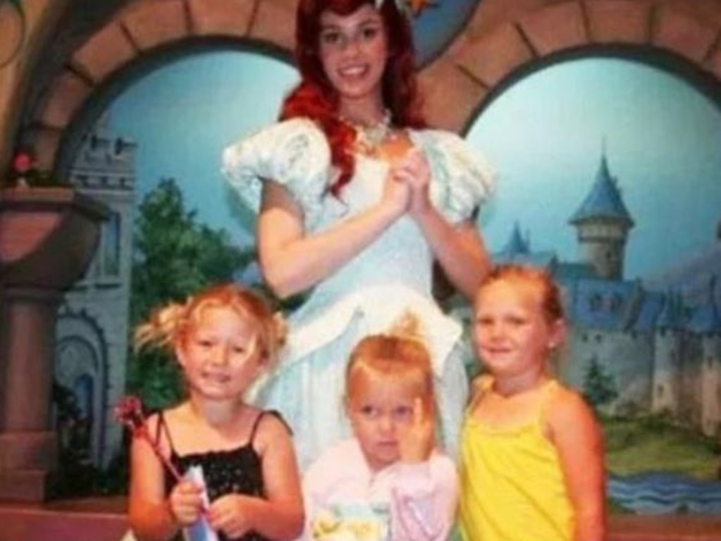 … And the kid in the middle who perfectly expressed her feelings on her day out at Disneyland. Picture: Reddit
