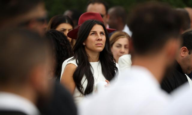 Mother Leila Abdallah reflecting as the song Oceans by Hillsong worship choir plays at the funeral for her children Anthony, Angelina and Sienna Abdallah at the Our Lady of Lebanon Cathedral in Harris Park. Picture: Jonathan Ng
