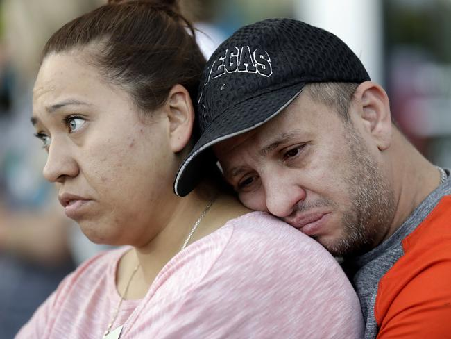 Rosa and Alan Duarte become emotional during a vigil at City Hall in Las Vegas. Picture: AP