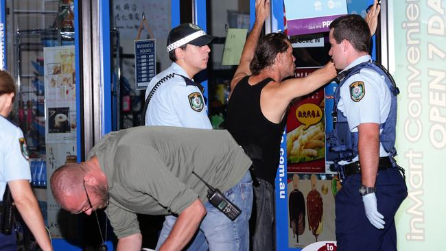 Two men and a woman were searched following the altercation. Picture: Bill Hearne