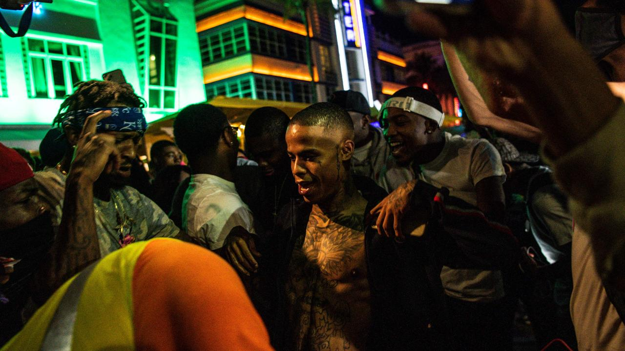 Despite strict COVID measures amid new waves of infection, the US city of Miami was overrun by massive crowds of young people celebrating Spring Break, sparking a state of emergency. Picture: AFP