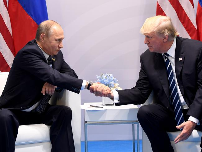 US President Donald Trump and Russia's President Vladimir Putin shake hands during the G20 Summit. Picture: AFP
