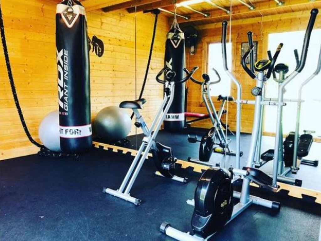 Deborah runs Zoom boxing sessions from her home gym. Picture: Instagram/dgboxingcoach
