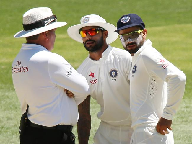 Shikhar Dhawan and Virat Kohli of India speak to the umpire after an altercation with Warner.