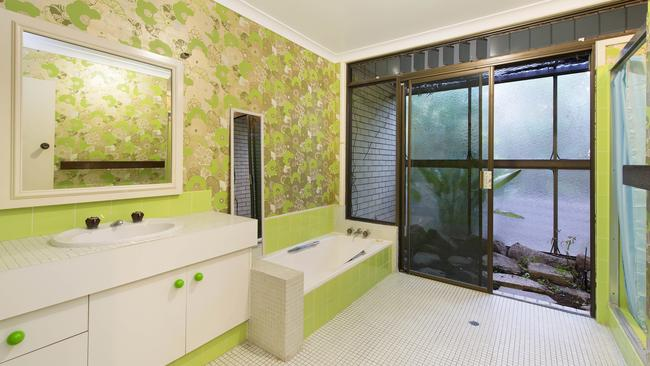 Lime green makes the bathroom standout.