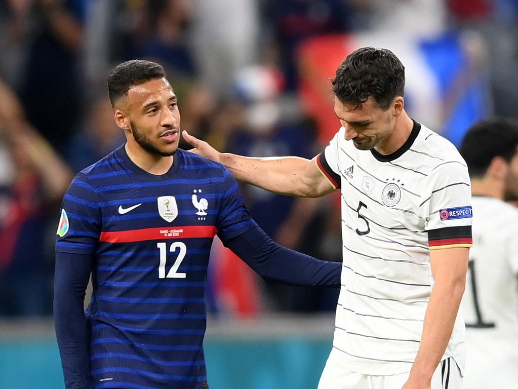 Corentin Tolisso of France and Mats Hummels of Germany.