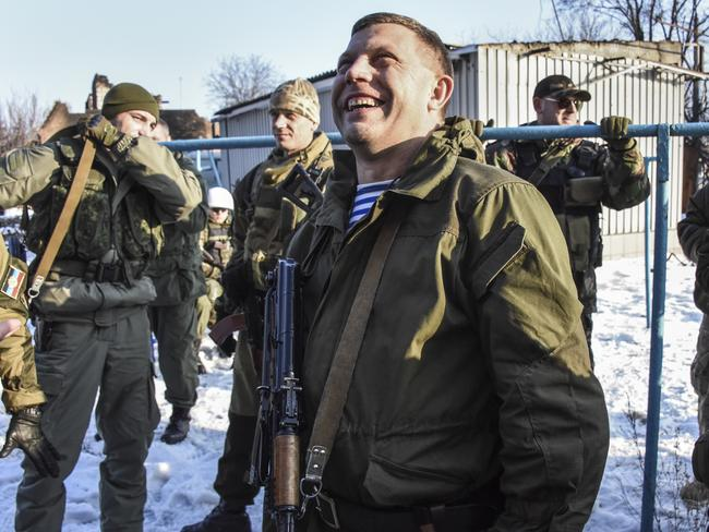 No end to the fighting ... pro-Russian rebel leader Alexander Zakharchenko surrounded by guards. Picture: AP Photo/Mstyslav Chernov