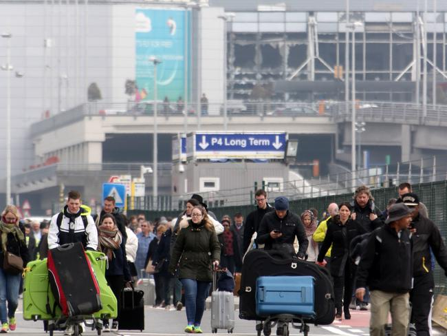 Passengers are evacuated from Zaventem Bruxelles International Airport after a terrorist attack on March 22, 2016 in Brussels, Belgium.