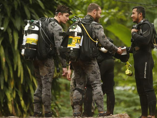 Australian Federal Police divers talk to a Thai rescuer at the scene. Picture: AP