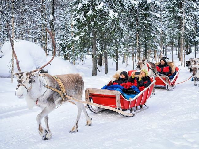 VISIT LAPLAND, SANTA'S HOMETOWN Lapland is all about the magic of winter and what could be more magical than a visit to Santa's home town? The charming snow-covered village of Rovaniemi sparkles under the pale winter sunas reindeers pull sleighs through forests of coniferous trees heavy with snow. Inside a cosy log cabin filled with presents, a twinkly-eyed Santa waits for his delighted small visitors. In another little cottage nearby, children can help Mrs Claus and her elves bake traditional gingerbread. You can stay in the village, but 25 minutes away are luxurious glass igloos with 360-degree views of the Arctic sky and auroraalarms to alert you if the Northern Lights appear.