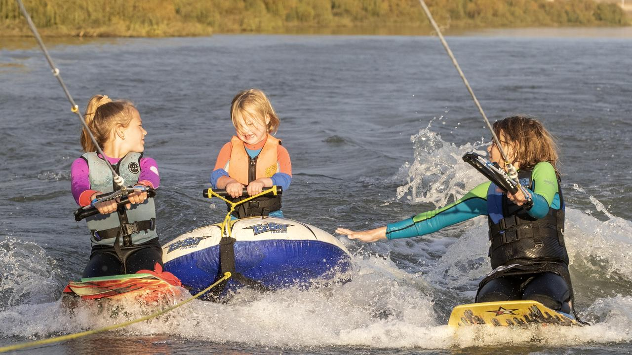 Reef Fahey, 12 (right), is planning to ski 213km to raise awareness for T21 (Down syndrome) and Ski for Life. Reef with his sister Mahala, 10 (left) and brother Koa, 5 (centre), at Murray Bridge, SA, May 6, 2021. Picture: Simon Cross