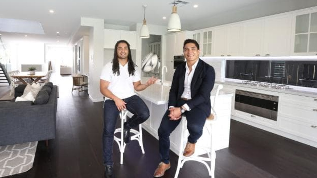 Star rugby players Saia and Anthony Fainga'a at the Camp Hill investment property they have put on the market Photo: Annette Dew