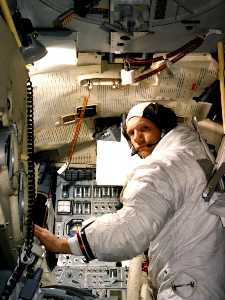 "This undated image obtained from NASA shows Astronaut Neil A. Armstrong, commander for the Apollo 11 Moon-landing mission, training for the historic event in a Lunar Module simulator in the Flight Crew Training Building at the Kennedy Space Center in Florida. Accompanying Armstrong on the Moon flight will be Command Module Pilot Michael Collins and Lunar Module Pilot Edwin E. Aldrin Jr.  Armstrong has died, US media reported August 25, 2012. He was 82. Armstrong underwent cardiac bypass surgery, earlier this month after doctors found blockages in his coronary arteries. He and fellow Apollo 11 astronaut Buzz Aldrin landed on the moon on July 20, 1969, before the eyes of hundreds of millions of awed television viewers worldwide.    = RESTRICTED TO EDITORIAL USE - MANDATORY CREDIT ""AFP PHOTO / NASA"" - NO MARKETING NO ADVERTISING CAMPAIGNS - DISTRIBUTED AS A SERVICE TO CLIENTS ="