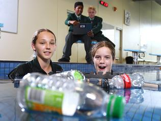 Westminster School Year 7 students Ashwin and Axel guide one of their prototype Sphero Bolt Driven Water Collection Devices watched by Anna and Aijay in the schools pool Thursday ,June,3,2021.Picture Mark Brake