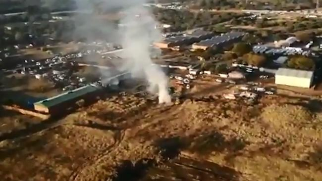 The plane crashed through a factory building, injuring three workers.