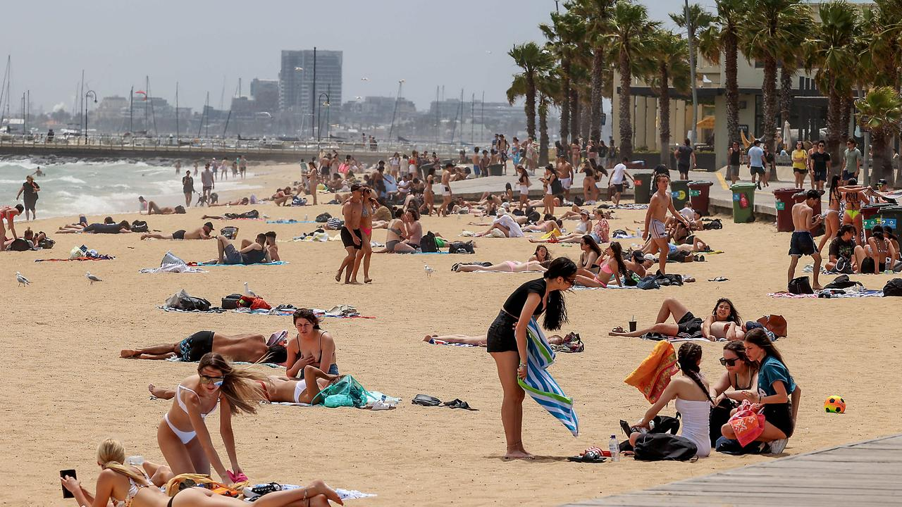 Melburnians soak up the sun at St Kilda beach after a hot 30C day. Picture: NCA NewsWire / Ian Currie