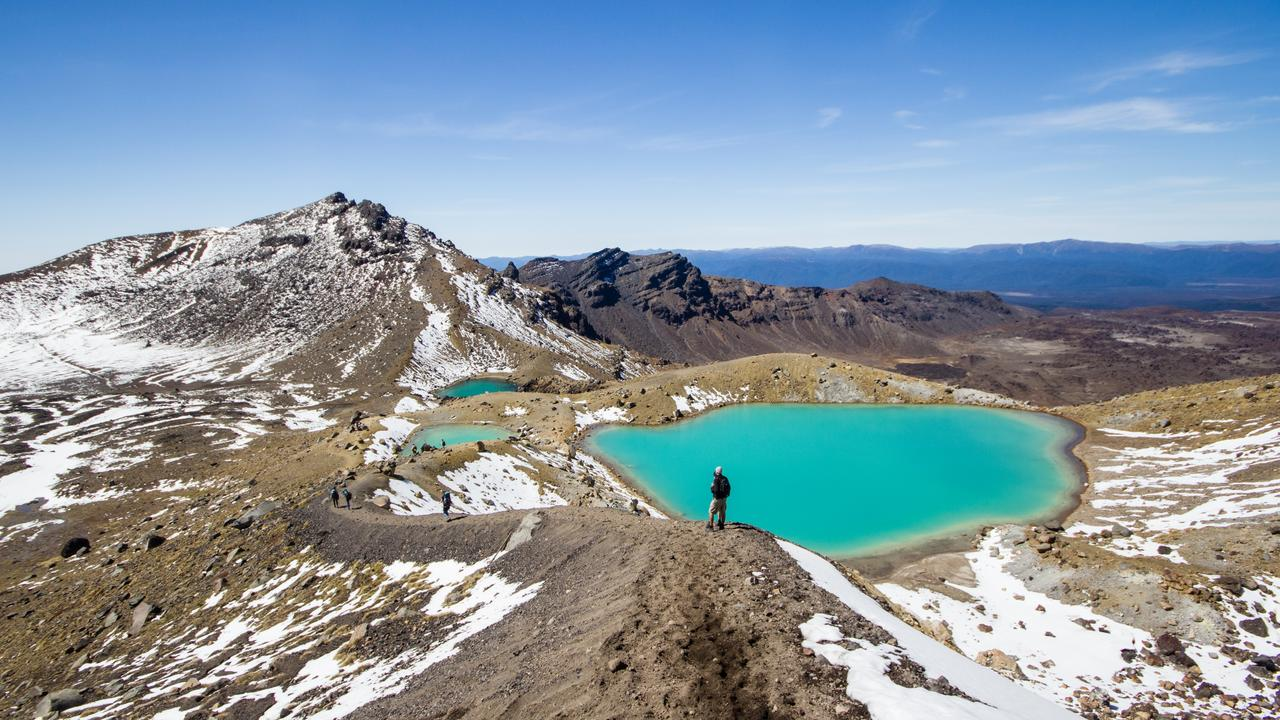 Marvel at emerald lakes of the Tongariri Alpine Crossing in New Zealand.