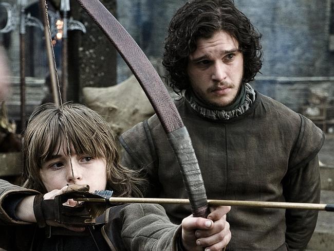 "Isaac Hempsted Wright As Bran Stark and Kit Harrington As Jon Snow in ""Game Of Thrones""."