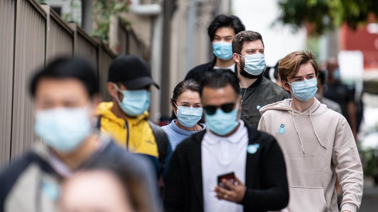 People queue to get vaccinated in Sydney. Picture: NCA NewsWire / James Gourley