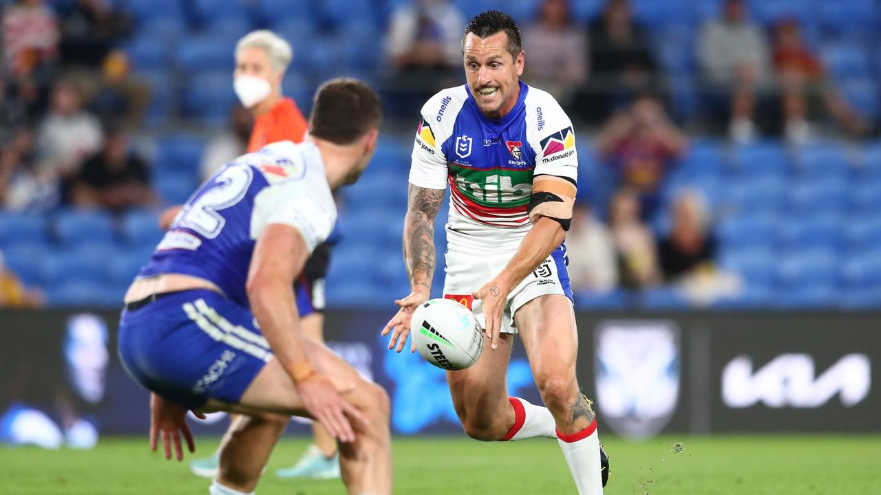 GOLD COAST, AUSTRALIA - AUGUST 21: Mitchell Pearce of the Knights kicks the ball during the round 23 NRL match between the Canterbury Bulldogs and the Newcastle Knights at Cbus Super Stadium, on August 21, 2021, in Gold Coast, Australia. (Photo by Chris Hyde/Getty Images)