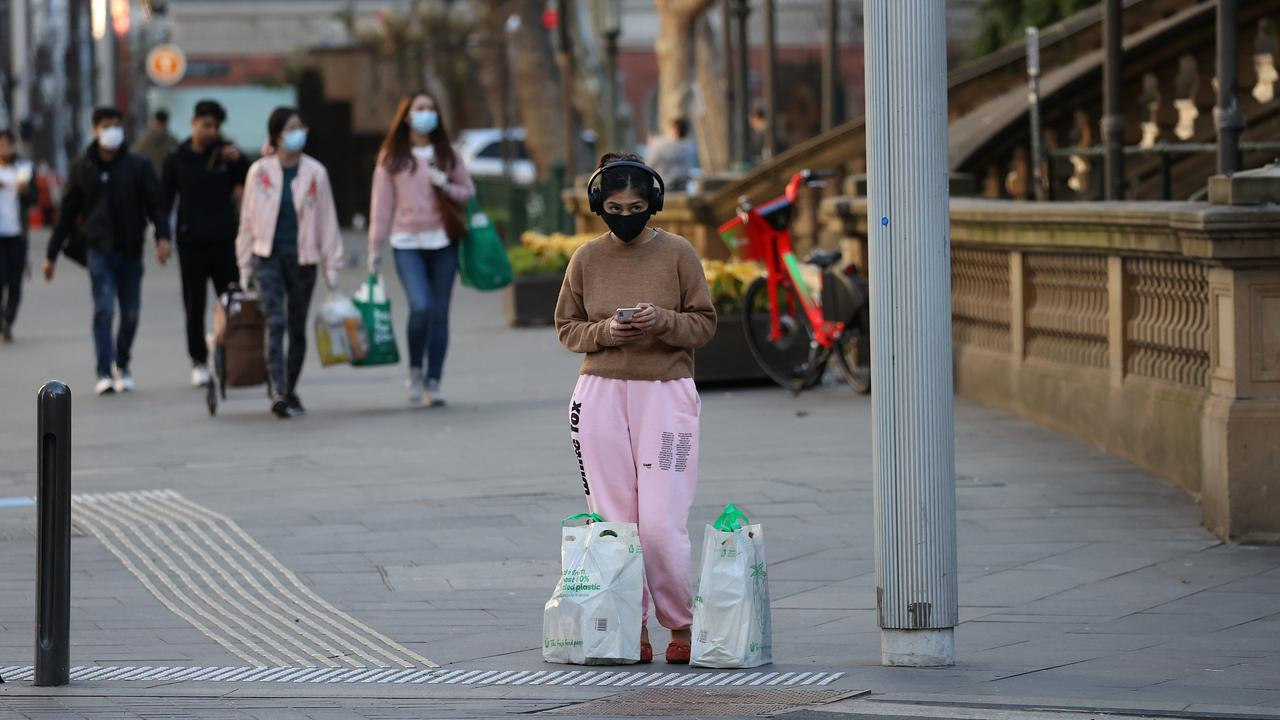 A woman with her shopping near Town Hall in Sydney CBD. Picture: Dylan Coker/NCA NewsWire