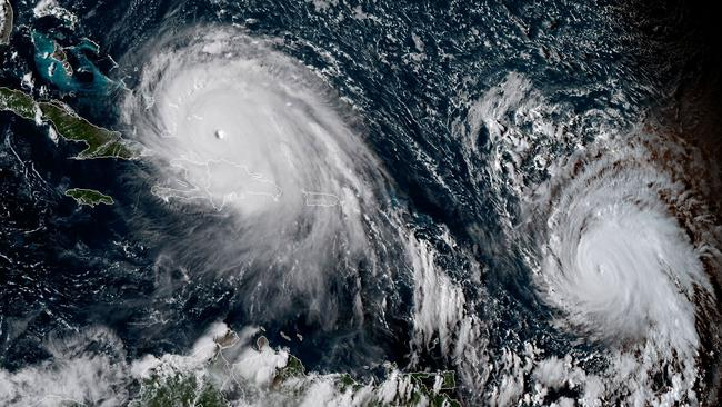 """This satellite image obtained from the National Oceanic and Atmospheric Administration (NOAA) shows Hurricane Irma (L) and Jose (R) at 2015UTC on September 7, 2017.  Jose strengthened to a Category Three storm on September 7, as it followed in the path of Irma, US weather forecasters said. The National Hurricane Center said the storm, located east of the Lesser Antilles, was packing winds of 120 miles per hour (195 kilometers per hour), as it moved northwest at nearly 18 miles per hour (30 kilometers per hour). / AFP PHOTO / NOAA/RAMMB / Jose ROMERO / RESTRICTED TO EDITORIAL USE - MANDATORY CREDIT """"AFP PHOTO / NOAA/RAMMB"""" - NO MARKETING NO ADVERTISING CAMPAIGNS - DISTRIBUTED AS A SERVICE TO CLIENTS"""