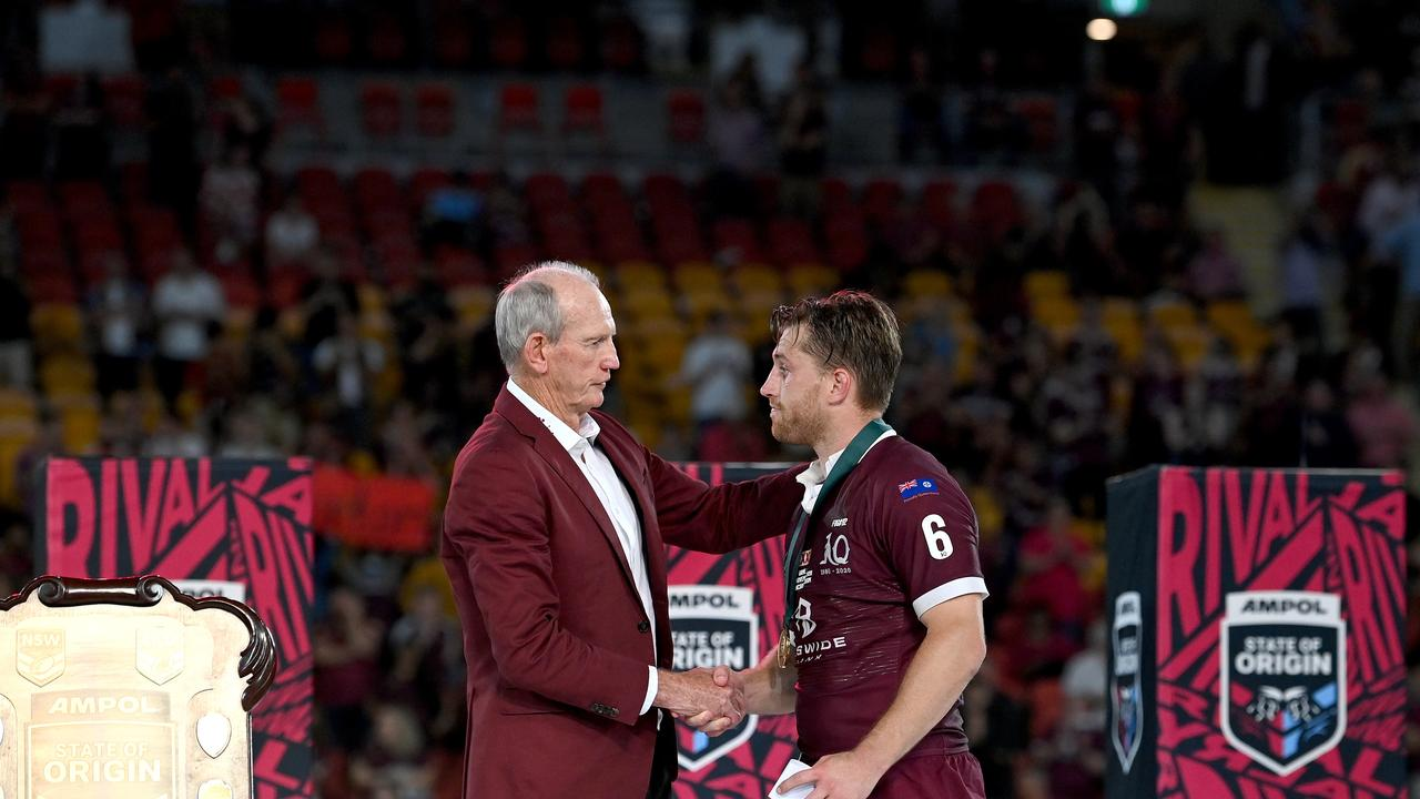 BRISBANE, AUSTRALIA - NOVEMBER 18: Cameron Munster of the Maroons is presented with the man of the match award by Maroons coach Wayne Bennett after game three of the State of Origin series between the Queensland Maroons and the New South Wales Blues at Suncorp Stadium on November 18, 2020 in Brisbane, Australia. (Photo by Bradley Kanaris/Getty Images)