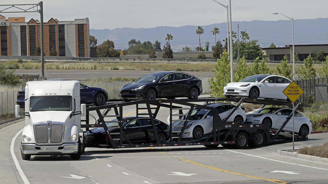 A truck hauling new Tesla vehicles leaves the plant in Fremont. Picture: Ben Margot/AP