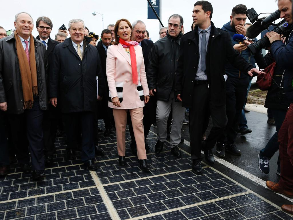 French Minister for Ecology, Sustainable Development and Energy Segolene Royal walks with other officials on a solar panel road during its inauguration in Tourouvre, France. Picture: Charly Triballeau
