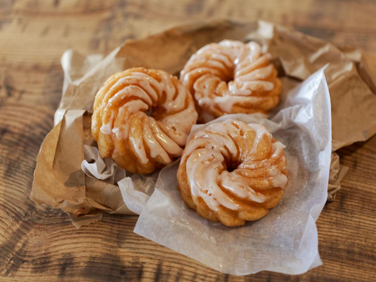 Spritzkuchen (German fried pastry) with brown and white wrapping paper