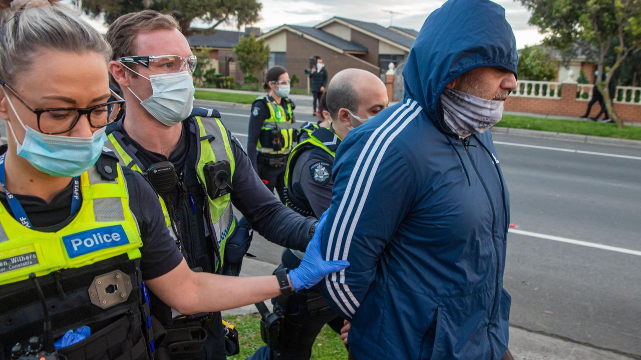 Police threatened to use pepper spray in a tense stand-off with anti-lockdown protesters in Dandenong. Officers clashed with a group of about 100 people who marched along Kirkham Rd about 5.20pm. Picture: Jason Edwards