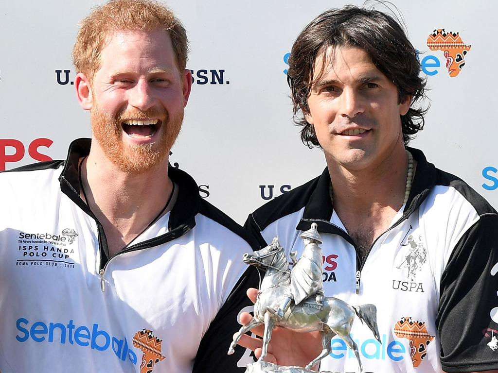 Prince Harry and polo team captain and friend Nacho Figueras. Picture: AFP
