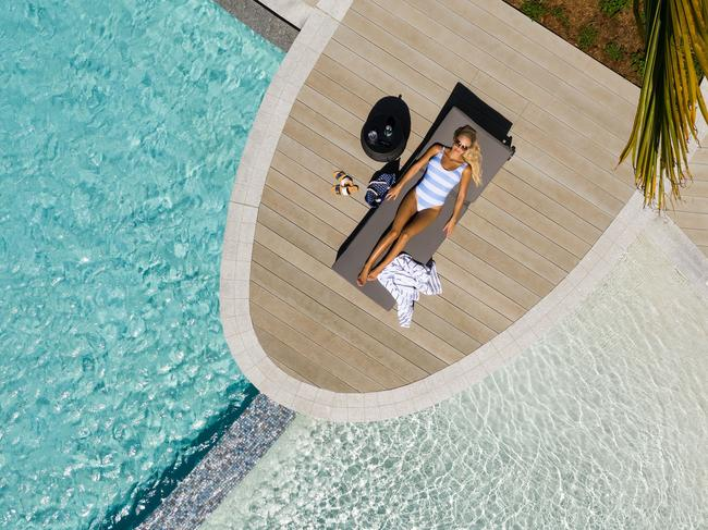 3. LAP UP LUXURY Cairns Esplanade has a new kid on the block and his name is Riley. The five-star resort — the city's first in 20 years — will have you wishing you'd packed more linens. All cream colours, light wood and coral pieces, it's heaven for neutral decor lovers. If you aren't staying here, at least swing by for cocktails at rooftop bar Rocco. You won't go wrong with its frosty, foamy espresso martinis served in Harry Potter-style gold goblets. Other good bets are a seaside meal at Asian restaurant Paper Crane or a hangover-curing Revitaliser drink from poolside cafe Greenfields. Two sister Crystalbrook Collection properties will open nearby later this year. Bailey will be artsy; Flynn, the wild child.