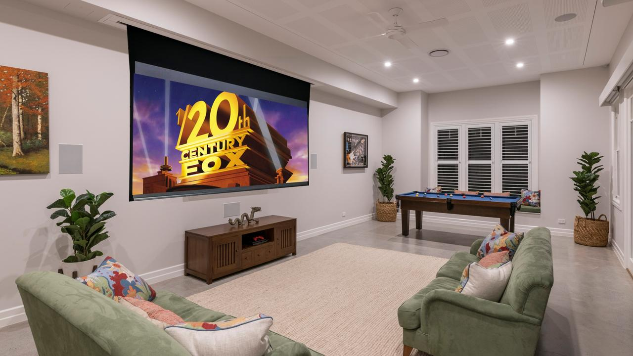 AFTER: The downstairs room is now a cinema and games room.