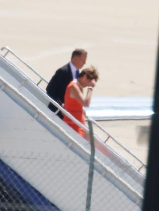 Touchdown in Canberra ... Mr Abbott with his wife Margie as they get off the plane. Picture: Gary Ramage