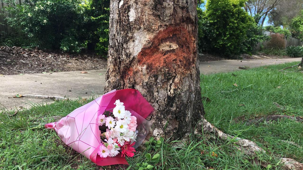 A touching tribute left at the scene where a 19-year-old man was killed in a motorcycle crash early Sunday morning in Douglas.