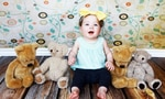 baby with soft toys cuddly toys