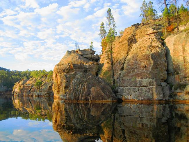 GANGUDDY/DUNNS SWAMP IN WOLLEMI NATIONAL PARK, NEAR RYLSTONE: A gorgeously serene waterway, drive to Dunns Swamp for a weekend of nature-watching, fishing, camping and swimming. if you're lucky, you might spot a platypus or a long-necked turtle. Picture: NSW National Parks and Wildlife