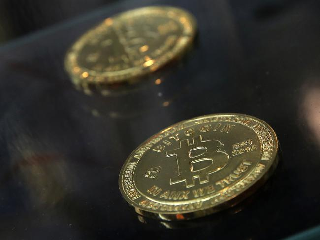 Coins are displayed next to a Bitcoin ATM in Hong Kong. Picture: AP