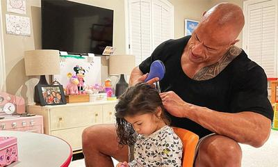 The Rock adorably styles his daughter's hair