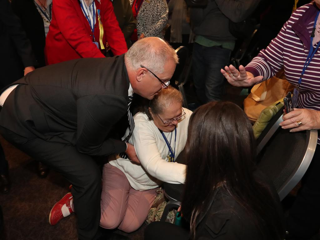 The Prime Minister focused on helping a woman who had been knocked over. Picture: Alex Coppel.