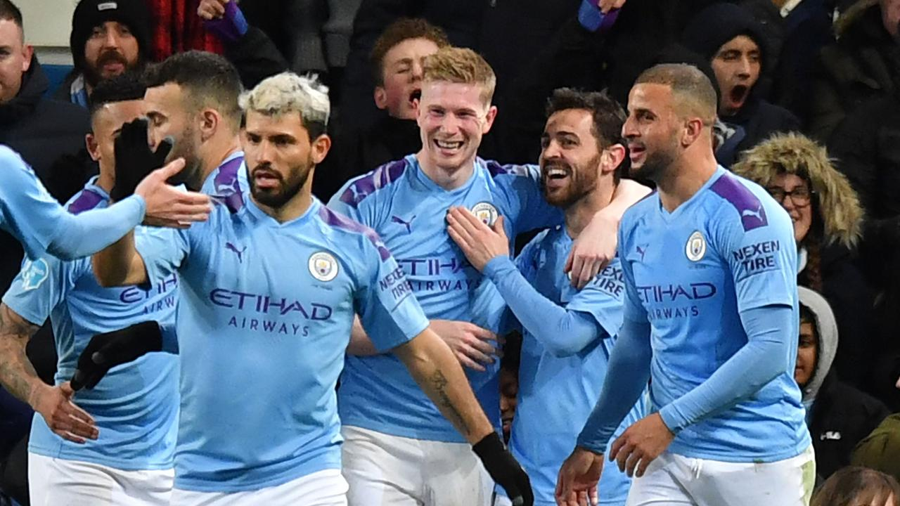 Manchester City's Belgian midfielder Kevin De Bruyne celebrates with teammates after scoring their second goal.