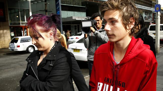 The couple's two children, Kimberley and Dylan Fesus, leave an earlier court appearance after their father was charged.
