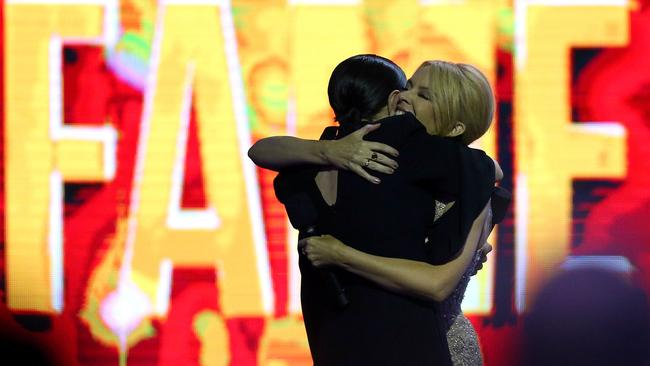 Celebrations ... Kylie Minogue embraces Tina Arena as she inducts her into the ARIA Hall Of Fame. Picture: Graham Denholm/Getty Images