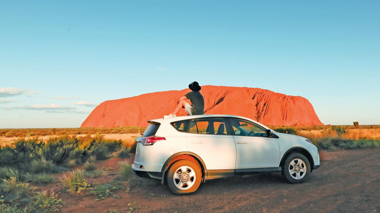 Catching a sunset at Uluru. Picture: Tyson Mayr