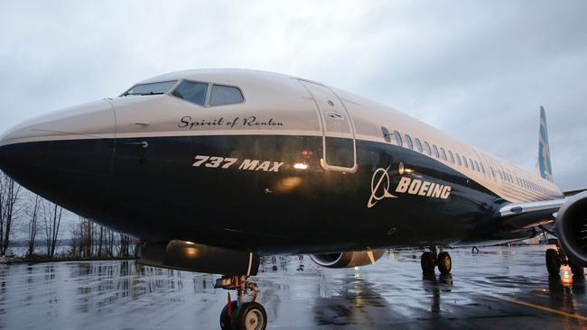 """Boeing's first 737 MAX, named """"Spirit of Renton"""", parked on the tarmac at the Boeing factory in Renton, Washington in December 2015. American Airlines has ordered four of these planes, which come without backseat monitors. Picture: AFP/Jason Redmond"""