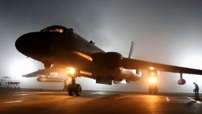 A Chinese state media image of a H-6K strategic bomber being prepared for take-off. The US has criticised 'attack runs' made by the aircraft against its major military bases at Guam.