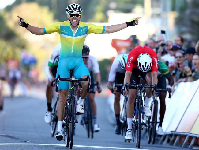 Steele Von Hoff of Australia (L) celebrates victory in the Men's Road Race