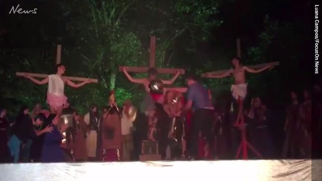 Audience member runs on stage to 'save Jesus from being crucified'